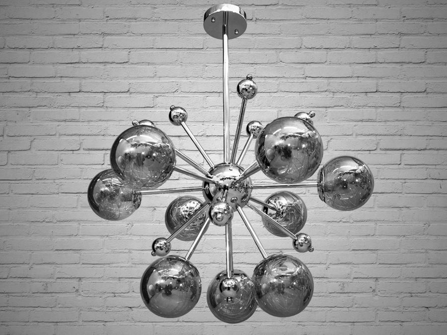 Лаконичный и в тоже время очень стильный дизайн этой люстры на 9 ламп в стиле лофт подойдет для ценителей минимализма и свободы мысли в интерьере. Стиль «Лофт» сейчас очень популярен, его любят как творческие личности, так и весьма практичные люди, предпочитающие комфорт и простоту в интерьере. Люстры в стиле «лофт» идеально впишутся в современные дома, квартиры, кафе, арт-пространства, коворкинги, квеструмы. За счет регулировки шнура можно подобрать оптимальную высоту светильника. В отличие от привычной люстры-молекулы, эта люстра укомплектована более изящными небольшими плафонами. Люстра специально разработана под светодиодные лампы стандарта G45 с цоколем Е27.