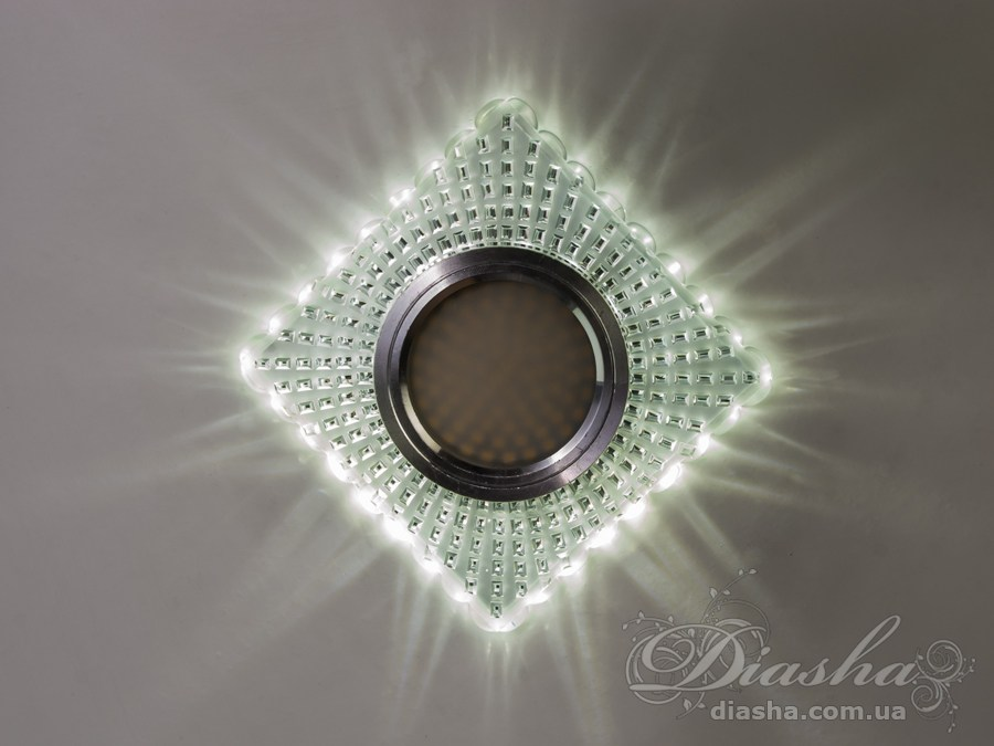 Врезные хрустальные точечные светильники под лампу MR-16это новые технологии в точечном освещении! Светильник оснащен встроенным LED модулем 5W, что дает ему возможность распределения на три включения (двойной выключатель): лампа, встроенная подсветка, и одновременно и лампа и подсветка. Режим подсветки можно использовать, как самостоятельный заполняющий свет - свет преломляется в сотнях граней точечного светильника и равномерно распределяется по помещению. Основная лампа стандарта MR-16 наоборот даёт основную часть светового потока строго вниз - этот режим хорош для подсветки стола/рабочей поверхности, чтения и тд.Светильник экономичен, красив, современен и изготовлен из качественного хрясталя, что обеспечивает ему хорошее преломление света и образование четких ярких бликов. Точечные светильники просты и легки в установке, поэтому их монтирование не займет много времени и труда. Они запросто могут изменить пространство помещения. Если точечные светильники установить по периметру потолка, то он будет казаться выше, а сама комната – намного больше.Конструкция светильника идеально расчитана на использование с натяжными потолками.Примите это как руководство к действию. И тогда эти хрустальные точечные светильники будутспособны обеспечить Вам комфорт именно на том уровне, которого Вы так долго ждали! Для оптовых покупателей отпускается только ящиками по 50 шт.Лампа в комплект не входит.