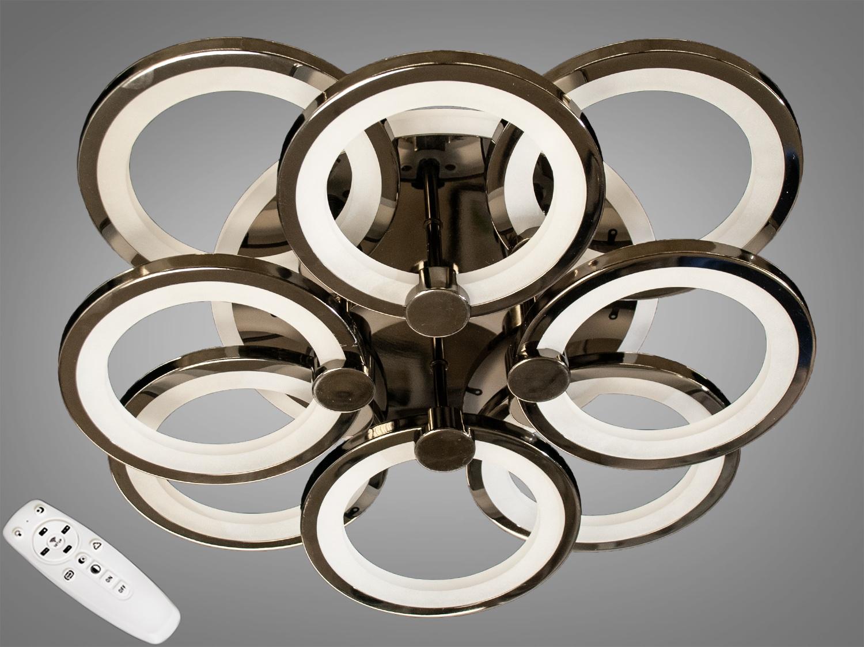 Встречайте самую хитовую модель в цвете чёрный хром! Светодиодная люстра имеет несколько режимов: холодный 6400К, нейтральный 4500К, тёплый 2700К, цветнаяLEDподсветка,совмещённый режим — любой основной свет плюс светодиодная подсветка — всё зависит от вашего настроения! Потолочный светильник имеет электронный димер, что позволяет регулировать яркость люстры от 5% до 100% при помощи пульта, который поставляется вместе с люстрой. В дополнение к стандартным режимам светодиодной люстры, добавлен режим цветной подсветки. Люстра способна наполнить комнату приятным цветным переливом - за 2 минуты в режиме подсветки люстра проходит все цвета радуги. Светодиодные люстры этой серии стали идеальным светильником в детскую. Отсутсвие стеклянных частей и припотолочная компоновка люстры позволяет пережить ей любое детское веселье, а приятный многоцветный свет можно смело оставлять как ночник. Люстра светит ярко, но не слепит за счёт материала — акрила, к тому же этот материал очень прочен — его трудно повредить. Лёгкий вес, небольшая высота, оригинальный дизайн с хромированными частями, пульт, димер, дополнительная подсветка — вам обязательно понравятся наши люстры!