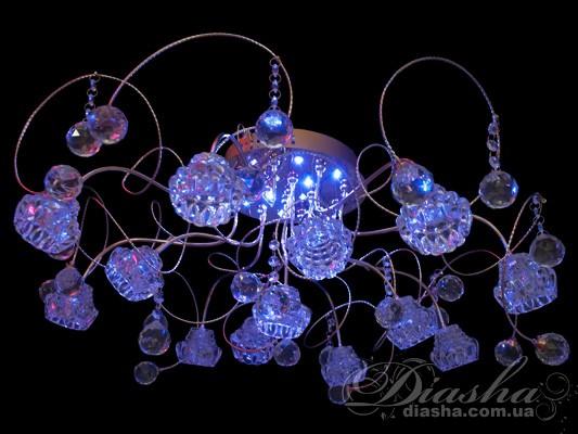 Неожиданное новшество серии «люстры-модерн» принесет в ваш дом уют и романтический свет. К знакомой всем диодной подсветке синего цвета добавлены нежные оттенки розового и страстные блики красного. Новые люстры с диодной подсветкой замечательно украсят ваше жилище и подарят вам незабываемые ощущения праздника. Диодные светильники модерн всегда к месту в любом помещении, будь то элитный ресторан либо офис, спальня или гостиная. Изящество линий, стильный дизайн, оригинальные цвета диодов – это не только красота, это всегда хорошее настроение! Диодная подсветка в галогеновых люстрах имеет следующие режимы: перелив - плавный переход синий-розовый-красный-розовый-синий, смена цветов - синий-розовый-красный горят по выбору от 1 до 5 секунд, а также остановленный цвет. Все управление светодиодами производится при помощи одной кнопки на пульте!!!