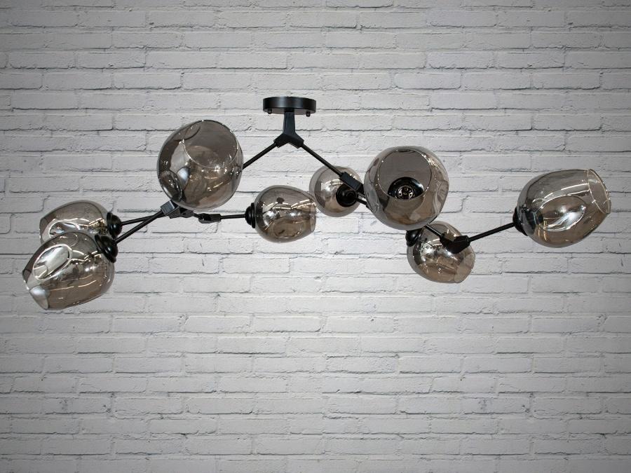 Лаконичный и в тоже время очень стильный дизайн этой люстры на 8 ламп в стиле лофт подойдет для ценителей минимализма и свободы мысли в интерьере. Стиль «Лофт» сейчас очень популярен, его любят как творческие личности, так и весьма практичные люди, предпочитающие комфорт и простоту в интерьере. Люстры в стиле «лофт» идеально впишутся в современные дома, квартиры, кафе, арт-пространства, коворкинги, квеструмы. За счет регулировки шнура можно подобрать оптимальную высоту светильника. Несмотря на похожесть люстры на привычных представителей серии