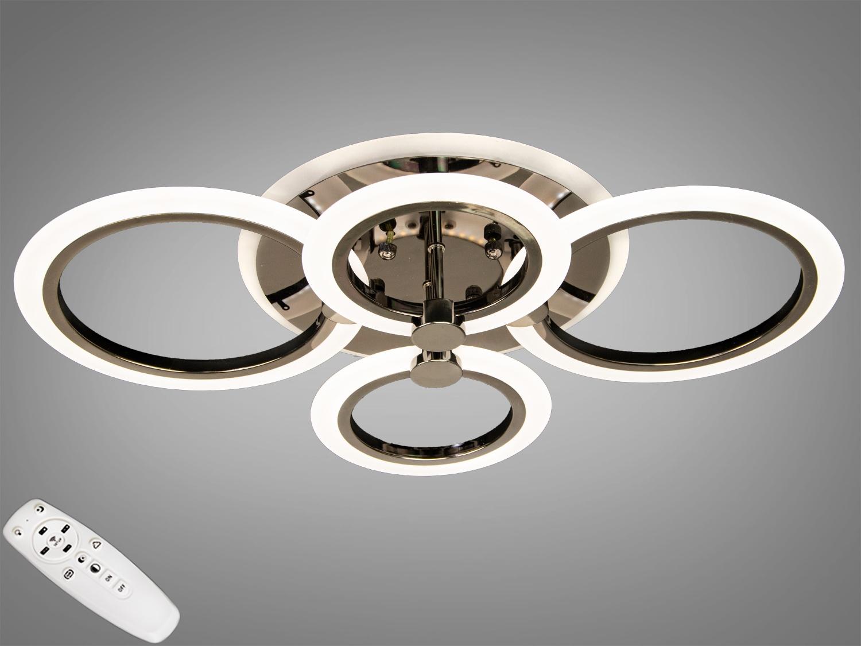 Встречайте самую хитовую модель в цвете чёрный хром! Светодиодная люстра имеет несколько режимов: холодный 6400К, нейтральный 4500К, тёплый 2700К, синяяLEDподсветка,совмещённый режим — любой основной свет плюс светодиодная подсветка — всё зависит от вашего настроения! Потолочный светильник имеет электронный димер, что позволяет регулировать яркость люстры от 5% до 100% при помощи пульта, который поставляется вместе с люстрой. В дополнение к стандартным режимам светодиодной люстры, добавлен режим цветной подсветки. Люстра способна наполнить комнату приятным цветным переливом - за 2 минуты в режиме подсветки люстра проходит все цвета радуги. Светодиодные люстры этой серии стали идеальным светильником в детскую. Отсутсвие стеклянных частей и припотолочная компоновка люстры позволяет пережить ей любое детское веселье, а приятный многоцветный свет можно смело оставлять как ночник. Люстра светит ярко, но не слепит за счёт материала — акрила, к тому же этот материал очень прочен — его трудно повредить. Лёгкий вес, небольшая высота, оригинальный дизайн с хромированными частями, пульт, димер, дополнительная подсветка — вам обязательно понравятся наши люстры!