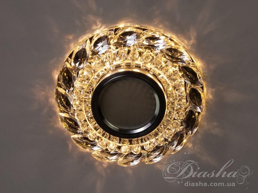 Врезные хрустальные точечные светильники под лампу MR-16это новые технологии в точечном освещении! Светильник оснащен встроенным LED модулем 5W, что дает ему возможность распределения на три включения (двойной выключатель): лампа, встроенная подсветка, и одновременно и лампа и подсветка. Режим подсветки можно использовать, как самостоятельный заполняющий свет - свет преломляется в сотнях граней точечного светильника и равномерно распределяется по помещению. Основная лампа стандарта MR-16 наоборот даёт основную часть светового потока строго вниз - этот режим хорош для подсветки стола/рабочей поверхности, чтения и тд.Светильник экономичен, красив, современен и изготовлен из качественного хрясталя, что обеспечивает ему хорошее преломление света и образование четких ярких бликов.  Точечные светильники просты и легки в установке, поэтому их монтирование не займет много времени и труда. Они запросто могут изменить пространство помещения. Если точечные светильники установить по периметру потолка, то он будет казаться выше, а сама комната – намного больше. Примите это как руководство к действию. И тогда эти хрустальные точечные светильники будутспособны обеспечить Вам комфорт именно на том уровне, которого Вы так долго ждали! Для оптовых покупателей отпускается только ящиками по 50 шт. Лампа в комплект не входит.