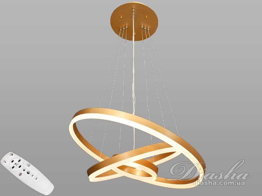 Светодиодные светильники «кольца» всегда будут в центре вашего внимания. Ведь за счёт регулировки шнура вы можете подвесить кольца по-разному, создавая свою личную композицию. Перед Вами совсем новое и необычное исполнение плафонов, обрамляющих LED лампы. Такая люстра запросто подойдет под любой интерьер – классический, современный и даже в стиле «хай-тек». В комплекте с люстрой идёт самый современный тип пульта с электронным диммером и регулятором цвета. С пульта можно включить один из предустановленных режимов освещения - тёплый свет, холодный свет, нейтральный; включить режим
