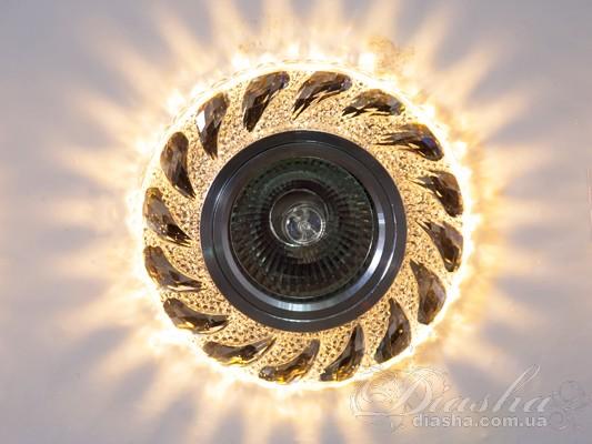 Обычно точечные светильники предназначаются для подвесных потолков и для подсветки различных нишили рабочей поверхности. Конструктивно точечный светильник состоит из двух частей: видимой - декоративной и встроенной – функциональной. Функциональная часть светильников состоит из каркаса, куда вставляется источник света и крепится декоративная часть, а также зажимов, которые предназначены для крепления светильника к потолку. Разнообразие декоративной части точечных светильниковпозволяет сделать Ваш интерьер неповторимым. Главные качества современных точечных светильников – это равномерное освещение всего помещения с возможностью акцентирования необходимых деталей интерьера. Точечные светильники произведенные из оптической смолы лучшее решение для натяжных потолков. Лёгкий корпус с оптическими характеристиками близкими к хрусталю. Стойкий к механическим повреждениям. Большой выбор моделей и цветов светильников. В светильник встроена подсветка мощностью 3Вт (цветовая температура 3200K - тёплый белый). Для оптовых покупателей отпускается только ящиками по 50шт. Лампа MR-16 и трансформатор в комплект не входят.